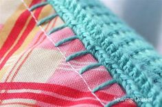 Crochet: Nacho Cushion -joining fabric to crochet via Blanket Stitch. Clever!