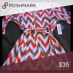 Chevron Dress Tan and Orange Chevron dress with beautiful detail,  95% polyester and 10% spandex. Tacera Dresses Midi