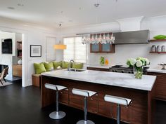Love this kitchen. The colors, barstool, floors and corner nook. Make it a cozy area. Designed by Linda Sullivan  www.sullivandesig...