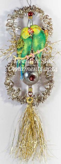 8 tall, including tinsel tail SPECIAL FEATURES  This is an antique tinsel and glass ornament; with its original fancy tinseled wire and
