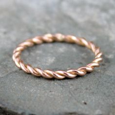 Completely hand made in my studio, this single stacking ring is made from 14K rose gold wire that I twisted myself in my studio to create a rope look. The Twist stacking ring measures approximately 1.5mm in width and is made to order in your finger size. Please indicate your finger size at the time of purchase. One of the special characteristics of handmade jewellery is that there will be subtle differences from piece to piece - your assurance of handmade quality. Each ring made will be…