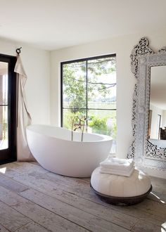 Bathroom in period property with wooden floors, large floor to celing mirror and large modern windows. :)