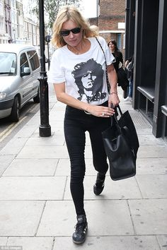 Off duty style: Kate Moss showed off her slim figure in a pair of ultra skinny jeans as sh...