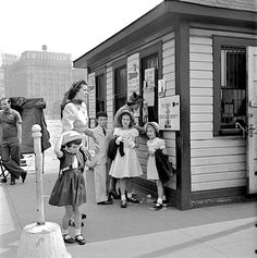 Sightseers at the ticket booth for the Statue of Liberty....1949 Photographer: Burt Ginn