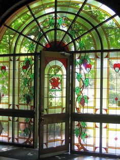 Arched Stained Glass Windows and Door.