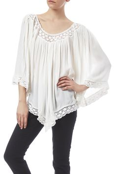 Off the shoulder top with elastic at the neckline and long sleeves. Off The Shoulder Flowy Top by Kelly Fields Boutique. Clothing - Tops - Long Sleeve Clothing - Tops - Blouses & Shirts Clothing - Tops - Off The Shoulder Missouri