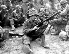 Pfc. Edward J. Foley of Methuen, Massachusetts, an American sniper with the U.S. 36th Infantry Division gives his rifle a thorough check before heading to the front during the Italian Campaign. Velletri, Province of Rome, Lazio, Italy. 20 May 1944.