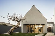 Completed in 2016 in Ilhavo, Portugal. Images by Fernando Guerra | FG+SG. This is not just another house. Those alleys were well known to us. Not that much...we used to run endlessly over there, always waiting for someone...