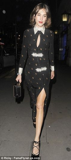 Alexa Chung looks chic in a silk patterned dress and patent boots in London | Daily Mail Online