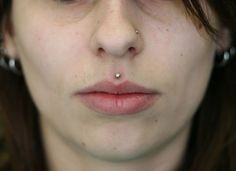 The medusa piercing also known as philtrum piercing. It is a beautiful piece of piercing set in the slope above your lip and directly under the septum of Dimple Piercing, Philtrum Piercing, Smiley Piercing, Piercing Aftercare, Piercing Tattoo, Ear Piercings, Medusa Piercing Jewelry, Piercing Shop, Vertical Labret Piercing
