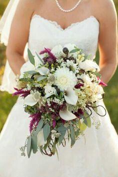 Bride's Bouquet Comprised Of: White Dahlias, White Calla Lilies, White Astrantia, White Spray Rose, Sangria Celosia, Fiddlehead Fern Shoots & Green Seeded Eucalyptus ••••
