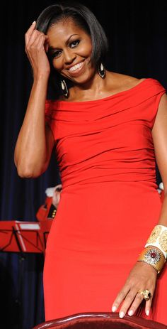 The First Lady at the 2010 WHCD. She accessorized her hand-draped Prabal Gurung gown with drop earrings and cuffs from Bochic (top) and Sutra Jewels (bottom).