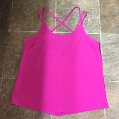 Athleta top Can be worn to workout or dressed up with jeans. Super light weight and comfortable. Like new condition Athleta Tops Tank Tops