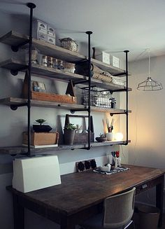 Industrial and rustic look. Shelf allows a lot of open workspace on the desk.