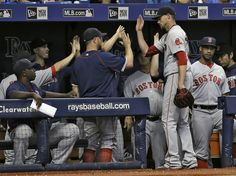 Red Sox starter Clay Buchholz was congratulated by teammates after he went 6⅓…