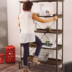Combining the industrial look of metal with the warmth of wood, our Emerson Shelving  boasts clean, contemporary design. Crafted of solid acacia and acacia veneer with powder-coated steel, our multi-functional shelving works anywhere from the office to the dining room.