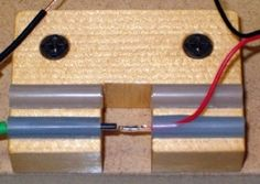 Wire Splicing Jig - Homemade wire splicing jig fashioned from spruce and fuel tubing.