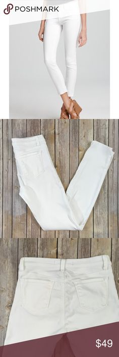 J Brand 811 Skinny Leg Snow Jeans J Brand 811 Skinny Leg Snow Jeans. Excellent condition. On-trend white denim is styled into a sleek, slim-leg silhouette fashioned from stretch denim with a flattering mid-rise waist. Zip fly with button closure. Five-pocket style. J Brand Jeans Skinny