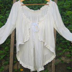 ..Lovely, white long sleeve light weight jacket...So feminine!
