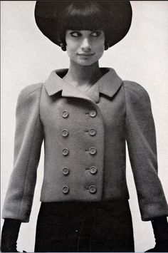1963 Charming, bright pink, fleece jacket worn over navy-blue wool dress by Marc Bohan for Dior