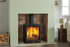The Stovax Vogue Medium wood burning stove boasts a nominal heat output, making it a great choice for larger living spaces. With a large stove window that features self-cleaning Airwash technology, the Medium's superb flame visuals provide a Log Burner Living Room, Log Burner Fireplace, Wood Burner, Home Living Room, Living Spaces, Fireplace Beam, Cottage Fireplace, Fireplace Design, Kitchen Living