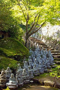 Small Buddha Statues line the stairs at Daisho-in temple, Miyajima, Japan.