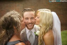 Kissed for the groom from Mother of the Groom and Bride. Newspin Photo