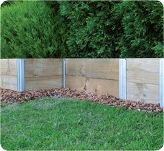 Pine Sleeper Retaining Wall Stained With Steps Leading Up