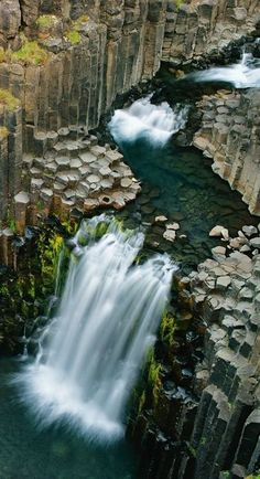 At Litlanesfoss, the waterfall cross-sections an ancient lava flow, which formed columns as it cooled. http://photography.nationalgeographic.com/photography/photo-of-the-day/litlanesfoss-waterfall-iceland/