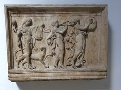 Frieze of a maenad and two satyrs  in a Dionysiac procession.Greek.