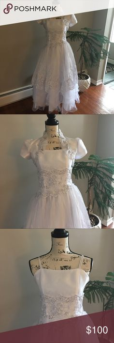 Girls white dress 10-13y Beautiful dress for First Communion 10-13 years. Dress like new. Dress used ones time . Dresses