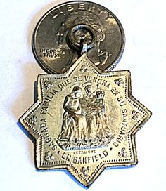 Large Antique 1898 Holy Family Medal St. Joseph Virgin Mary (Image1)Large star shaped antique religious medal dated 1898 and featuring the holy family: The blessed Mother Virgin Mary, Saint Joseph and the Christ child Jesus. Writing is in Spanish. Large size perfect for a man. Some wear to silver