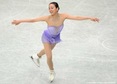 Mao Asada of Japan performs during her women's short program at the world figure skating championships in Saitama, on March 27, 2014. AFP PHOTO / TOSHIFUMI KITAMURA (1415×1023)