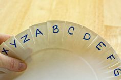 It's kind of like highway bingo we all loved. Write letters, shapes, colors, etc. - whatever you're working on around the edges of a paper plate. Your child folds them down as he sees them on a drive or walk! FUN!