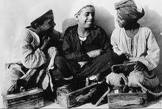 Egyptian shoe shine boys - street vendors, smiling, happy.