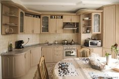Whitewashed Kitchen Cabinets | A Traditional Kitchen Featuring Whitewashed Maple Wood Cabinets An