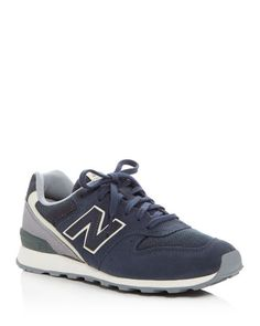 New Balance Women's 696 Lace Up Sneakers | Suede, synthetic textile and synthetic upper, synthetic textile lining, rubber sole | Imported | Fits true to size, order your normal size