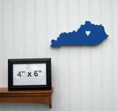 "Kentucky Wildcats  ""State Heart"" wall art, handcrafted wood with official team colors. $29.00, via Etsy."