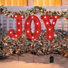spread the holiday word with this marquee style joy pathway marker this christmas decoration includes a timer option for 6 hr