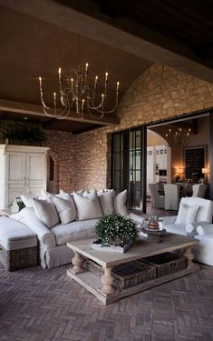 Covered outdoor living room, herringbone brick floors
