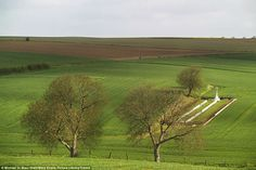 The Beaumont Hamel British Cemetery in Somme viewed from Hawthorn Ridge Redoubt. The two lines of graves, most of which contain unidentified soldiers' remains,  date from 1 July 1916 and early 1917 and they include a solitary German burial. Hawthorn Ridge Redoubt was a German stronghold which was attacked by the British who blew up a mine there on 1st of July 1916