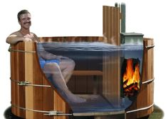 The wood fired hot tub is provided with a remote thermometer and an alarm that can be used to monitor the water temperature. If the water temperature is low, more fuel can be added. If the temperature is high, cold water can be added to the tub. Outdoor Tub, Outdoor Baths, Backyard, Patio, Firewood, Swimming Pools, Outdoor Living, Woodworking, Hot Tubs