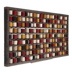 This stunning wall mounted piece of industrial history was sourced from a textile mill in the North of France. Originally there would have been long lines of these racks holding 1000s of bobbins to be used in making carpets. The bobbins themselves date from 1900 – 1940. All natural dyes hence the beautiful and subtle colours.  http://www.lorfordsantiques.com/product/WD386291-french-bobbin-rack