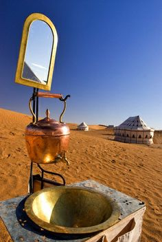 Morning wash in Morocco's Sahara desert. Yes this is beautiful. My morning wash was not quite like this although I wish I had this experience also.