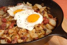 A corn beef hash and eggs breakfast skillet.