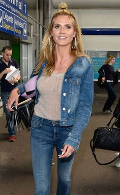 Heidi Klum from The Big Picture: Today's Hot Pics  Top knot, top model! The beauty is spotted in her Canadian tuxedo at the airport in Nice, France.