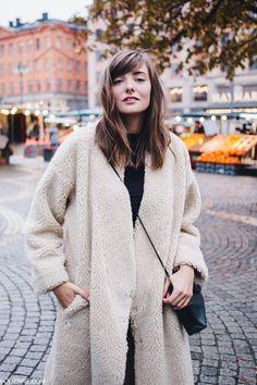 POLIENNE by Paulien Riemis | in Stockholm, wearing a MONKI sheep coat, H&M leather trousers, CONVERSE sneakers & COACH bag