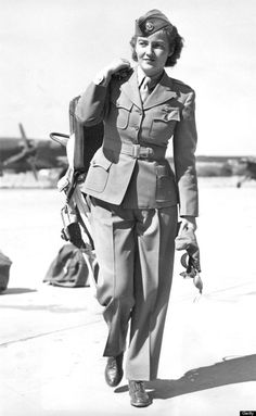 Women in WWII ~ women airforce service pilot Above: Nancy Harkness Love, an American pilot and Commander of the Women's Auxiliary Ferrying Squadron -- which was later absorbed into the Women's Airforce Service Pilots -- walks across a tarmac in England.~
