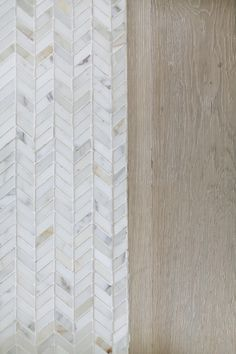 GOOD SITE Herringbone floor tile and white oak floor. Light wire brush white oak hardwood floor with marble herringbone tile. Winkle Custom Homes.