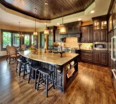 This room is a warm, open place for family to gather. The rich wood is elegant and classic. www.remodelworks.com